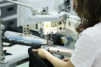 信源企業股份有限公司 - 高品質的成衣作工技術